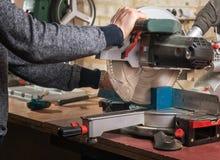 Carpenter cutting wood Stock Photos