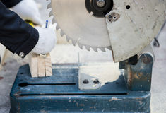 Carpenter cutting wood with electric saw Stock Photography