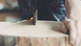Carpenter Cutting Wood With Handsaw In Workshop stock footage