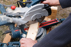Carpenter cutting wooden plank Royalty Free Stock Photos