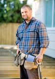 Carpenter With Digital Tablet And Hammer In Tool Royalty Free Stock Images