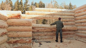 Carpenter directs the log is lifted by a crane. Canadian angle masonry. Canadian style. Wooden house made of logs. stock video
