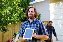 Carpenter displaying plans on tablet Stock Photography