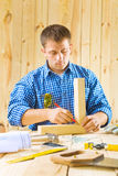 Carpenter does works with pencil Stock Photography