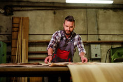 Carpenter doing his job in carpentry workshop Stock Images