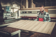 Carpenter doing his work in carpentry workshop. Stock Images