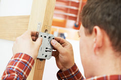 Carpenter at door installation Royalty Free Stock Photo