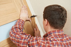 Carpenter at door lock installation Stock Photography
