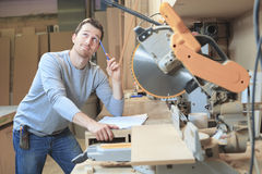 Carpenter at draw table in workshop Royalty Free Stock Photos