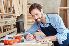 Carpenter drawing with joy Royalty Free Stock Images