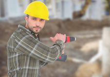 Carpenter with drill on building site Stock Images