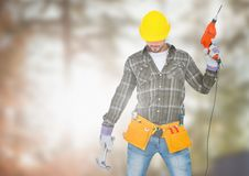 Carpenter  with drill posing on building site Royalty Free Stock Photography