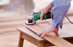 Carpenter drill wood for house construction Royalty Free Stock Images