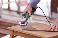 Carpenter drill wood for house construction Stock Photo
