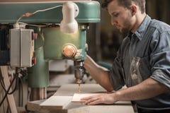 Carpenter drilling hole in dash Stock Photo