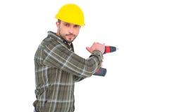 Carpenter drilling hole Stock Photos