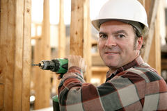 Carpenter Drilling Wood Stock Photography