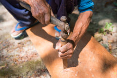 Carpenter is drilling wood Royalty Free Stock Photography