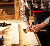 carpenter elderly working Arkivbilder