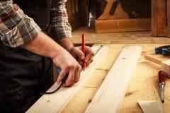 carpenter elderly working Royaltyfria Bilder