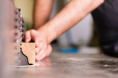 Carpenter with electric cutter Royalty Free Stock Photos