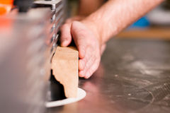 Carpenter with electric cutter Royalty Free Stock Image