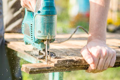 Carpenter with electric jig in park Royalty Free Stock Photo