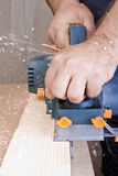 Carpenter with electric plane Royalty Free Stock Photography