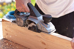 Carpenter with electric planes Royalty Free Stock Photos