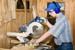 Carpenter & electric saw Stock Images