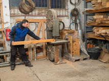 Carpenter on an electric saw machine Royalty Free Stock Photo
