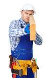 Carpenter examining a piece of wood Royalty Free Stock Photo