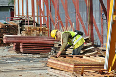 Carpenter fabricating timber form work at the construction site Stock Images