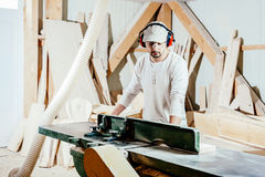 Carpenter in factory Royalty Free Stock Photography