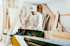 Carpenter in factory Stock Images