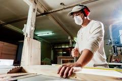 Carpenter in factory Stock Image