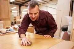 Carpenter Finishing Wood In Carpentry Workshop Royalty Free Stock Photos