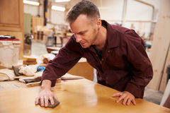 Carpenter Finishing Wood In Carpentry Workshop Stock Image