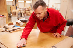 Carpenter Finishing Wood In Carpentry Workshop Stock Photos