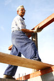 Carpenter fixing a long wood Stock Photo
