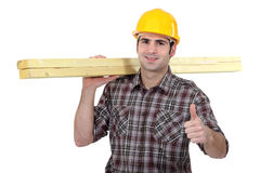 Carpenter giving thumbs-up Stock Photography