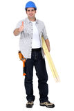 Carpenter giving thumbs-up Royalty Free Stock Images