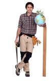 Carpenter with globe Stock Photo