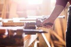 Carpenter gluing wooden planks Stock Photos
