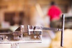 Carpenter gluing wooden planks Stock Photography