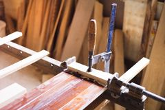 Carpenter gluing wooden planks Royalty Free Stock Photography