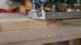 Carpenter grinds board grinding machine. close-up stock footage