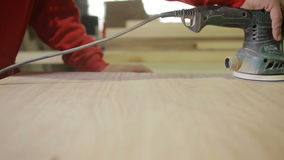 Carpenter grinds board grinding machine. close-up stock video footage