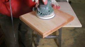 Carpenter grinds board grinding machine. close-up stock video