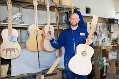 Carpenter and guitars that he made Royalty Free Stock Images